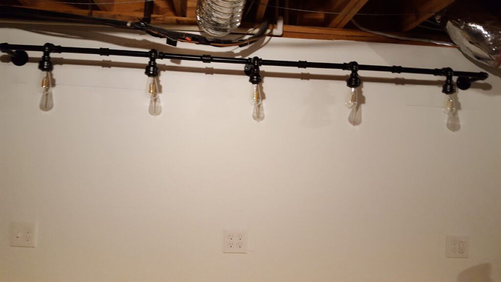 The finished light fixture mounted to the wall